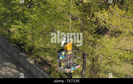 Kremenchug, Poltava region, Ukraine, April 25, 2019, improvement of the city replacement of street lighting lamps - Stock Photo