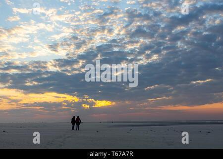 North Sea island Juist, East Frisia, Beach, people on the beach, at sunset, Lower Saxony, Germany, - Stock Photo
