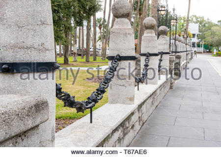 Massive decorative chains surround the main building at Flagler College, formerly the Ponce de Leon Hotel, in St Augustine, Florida USA - Stock Photo