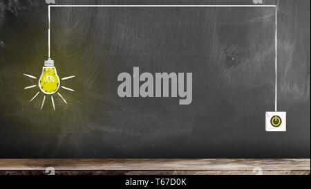 chalk drawing of glowing light bulb and switch on blackboard symbolizing an idea or innovation - Stock Photo