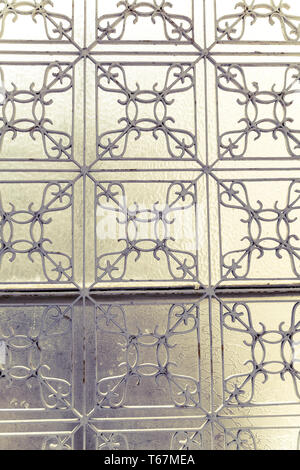 decorated metal fence in front of a window - Stock Photo