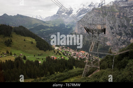 View down to Mürren from the Schilthorn cableway, with the Eiger and the Lauterbrunnen valley beyond and the Schwarzmönch and Trümmelbach Gorge in the - Stock Photo