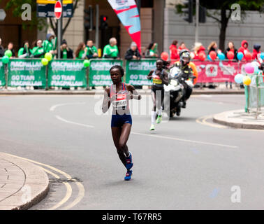 Brigid Kosgei (KEN), and Vivian Cheruiyot (KEN), competing in the Womens Elite 2019 London Marathon.  They went on to finish 1st and 2nd, respectively, in times of  02:18:20 and  02:20:14, respectively - Stock Photo