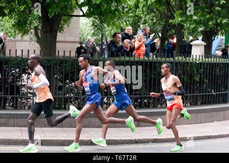 Eliud Kipchoge from Kenya, leading  the men's Elite 2019 London Marathon, from Mosinet Geremew, Tola Shura Kitata and Mule Wasihun, Eliud  went onto win in a time of 02:02:37 - Stock Photo