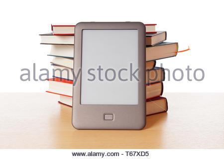 ebook reader vs pile of books - Stock Photo