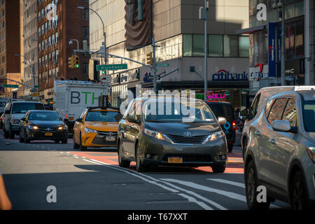 Traffic on 14th Street in New York on Wednesday, April 24, 2019. Because of the L train shutdown the city will ban private car through traffic between Third and Ninth Avenues on the thoroughfare. Buses will have priority as they shuttle commuters who would normally take the L train. The train service will be disrupted as necessary repairs on the Canarsie Tunnel take place starting Friday. The surface restrictions will start in June.  (© Richard B. Levine) - Stock Photo