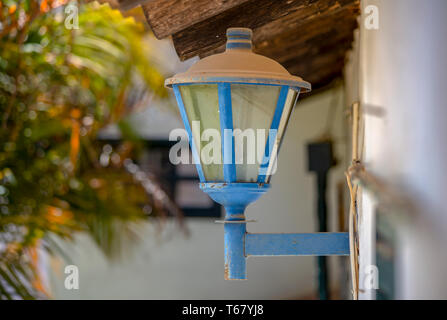 Multiple exposure of a dusty and rusty old electric lantern at the outside of a house. - Stock Photo