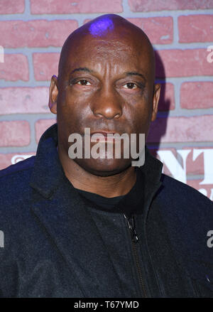 April 29, 2019 - Los Angeles, CA, U.S. - FILE PHOTO: JOHN SINGLETON, a versatile director who made a splash with ''Boyz n the Hood'' and went on to a variety of projects -- including ''2 Fast 2 Furious'' -- has died after suffering a stroke. He was 51. PICTURED: February 19, 2018 - Los Angeles, California - John Singleton attends FX's ''Atlanta Robbin' Season'' LA Premiere held at The ACE Hotel.  (Credit Image: © Birdie Thompson/AdMedia via ZUMA Wire) - Stock Photo