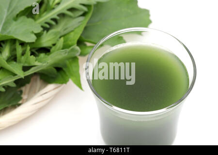 Glass of green vegetable juice on white background, Vegetable juice called 'aojiru' in Japan - Stock Photo