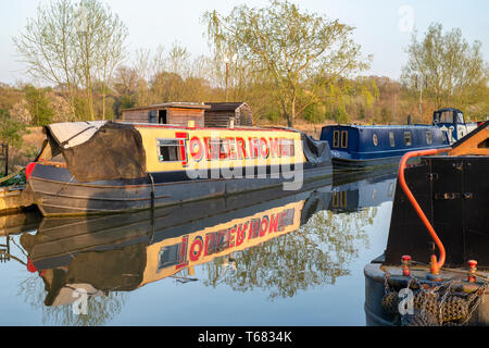 Toblerhome sign writing on a Canal boat on the oxford canal in the evening spring sunlight. Aynho Wharf, Oxfordshire, England - Stock Photo