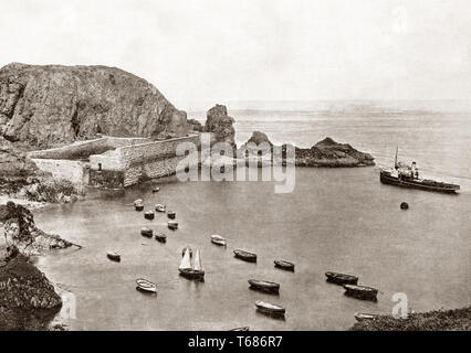 Late 19th Century view of Creux Harbour on Sark, an island in the Channel Islands,  Crown dependencies in the southwestern English Channel, off the coast of Normandy, France. It is a royal fief, which forms part of the Bailiwick of Guernsey, with its own set of laws based on Norman law and its own parliament. It is still one of the few remaining places in the world where cars are banned from roads and only tractors and horse-drawn vehicles are allowed. - Stock Photo