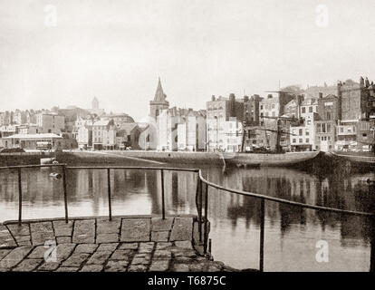 Late 19th Century view of the harbour of St Peter-Port, capital of Guernsey, an island in the Channel Islands Crown dependencies group located in the English Channel off the coast of Normandy. - Stock Photo