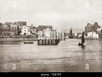 A 19th Century view of Castletown, a seaside town and small fishing port on the Isle of Man, a self-governing British Crown dependency in the Irish Sea between Great Britain and Ireland. The harbour is overlooked by Castle Rushen (left), originally built in 1265 for a Norse king, then fortified and added to by successive rulers between the 13th and 16th centuries. The town was the site of a number of sieges and battles, during the years when control of the island passed between the Norse, Scots and English. - Stock Photo