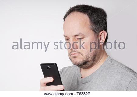 man looking at smart phone - Stock Photo