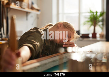 Female Artisan in Workshop - Stock Photo