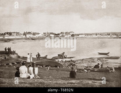 Late 19th Century view of Kilkee, a small coastal town in County Clare, Ireland midway between Kilrush and Doonbeg. With its horseshoe bay is protected from the Atlantic Ocean by the Duggerna Reef, the town became popular as a seaside resort in the 1820s when a paddle steamer service from Limerick to Kilrush was launched, attracting visitors. It became a premier bathing spot in what was then the United Kingdom of Great Britain and Ireland. - Stock Photo