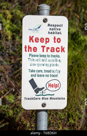 Blue Mountains, Australia - April 24 2019: New sign for track care in the Blue Mountains to protect the environment - Bush Regeneration Area - Please  - Stock Photo