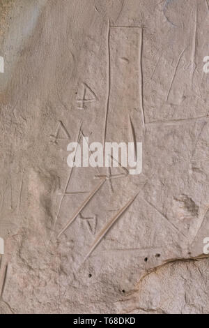 Ancestral Puebloan Petroglyphs of unknown meaning viewed along the Inscription Rock Trail in El Morro National Monument, New Mexico, USA - Stock Photo
