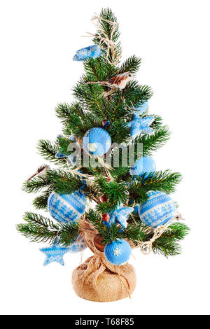 Christmas fir tree decorated with toys isolated on white background. - Stock Photo