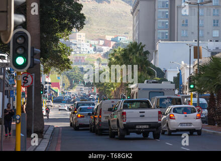 cars stopped and waiting at traffic lights in the city centre of Cape Town South Africa on a busy Autumn day looking toward Bo Kaap and Signal Hill - Stock Photo
