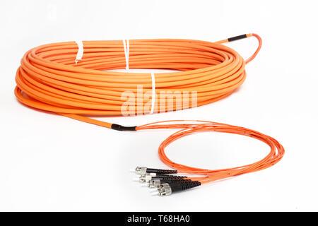 orange fiber optic ST connector patchcord - Stock Photo
