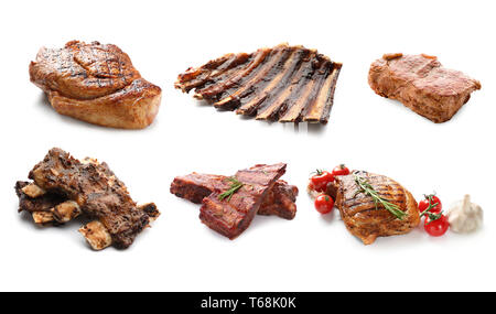 Different delicious grilled meat on white background - Stock Photo