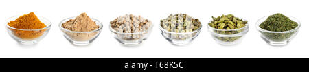 Different spices in bowls on white background - Stock Photo