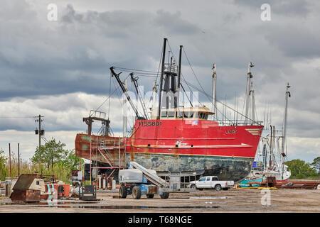 Fishing boat or trawler in dry dock for repair or retrofitting in Bayou La Batre Alabama, USA. - Stock Photo
