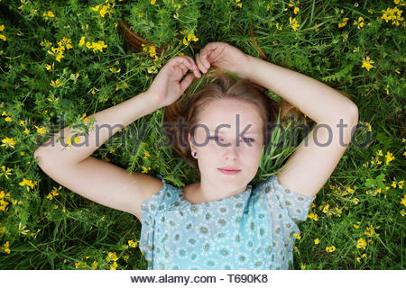young woman in a field of flowers - Stock Photo