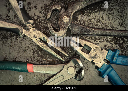 Various tools and instruments. Pincers, puller, pliers. - Stock Photo