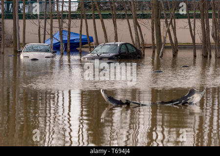 Pierrefonds-Roxboro, Quebec, Canada - 29 April 2019: Cars submerged during spring floods - Stock Photo