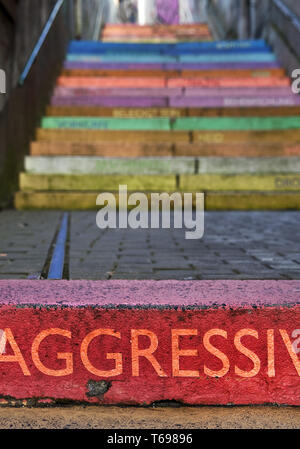 the word aggressive on colourful perron, Scala, Holsteiner Treppe, Wuppertal, Germany - Stock Photo