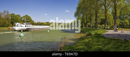 barge on Dortmund Ems Canal, Hoerstel, Muensterland, North Rhine-Westphalia, Germany - Stock Photo