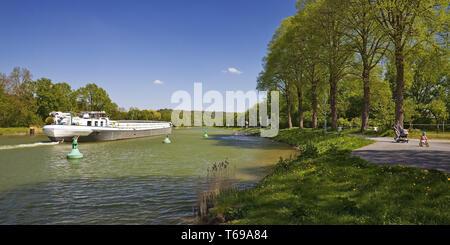barge on Dortmund Ems Canal, Hoerstel, Muensterland, North Rhine-Westphalia, Germany - Stock Photo