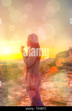 Abstract Blurred and soft photo of Women on hilltop - Stock Photo