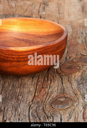 Empty Handmade Traditional Brown Bowl on Old Wooden Background. - Stock Photo