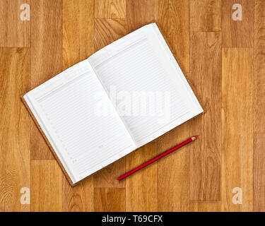 Blank notepad with office supplies on wooden table. - Stock Photo