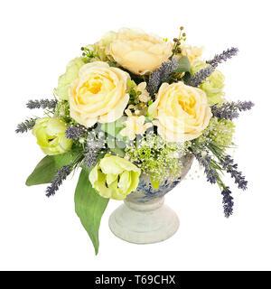 Bouquet from artificial flowers arrangement centerpiece in old vase.