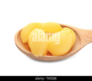 Wooden spoon with raw pasta on white background - Stock Photo
