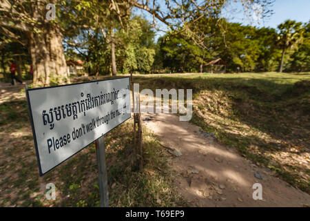 A sign at the monument in Phnom Penh to the victims of the Khmer Rouge at a mass grave site, Cambodia - Stock Photo
