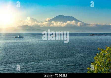 view on Bali from ocean, vulcano in clouds - Stock Photo
