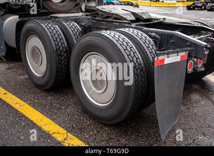 Wheelbase of industrial grade professional big rig freight transportation semi truck with two axles and twin wheels with full tread on them with mud f - Stock Photo
