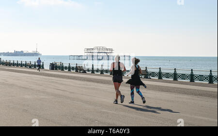 Brighton UK 30th April 2019 - Runners enjoy the warm sunny weather this morning on Hove seafront with it forecast to reach into the high teens in some parts of the South East today. Credit: Simon Dack/Alamy Live News - Stock Photo