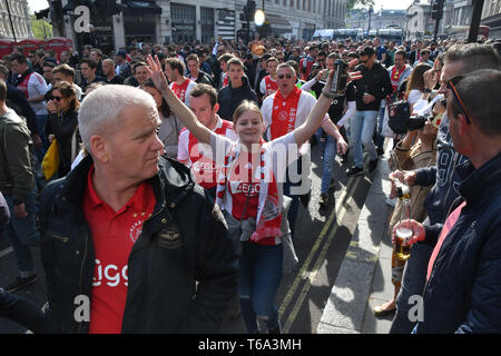 London, UK. 30th Apr 2019. AFC Ajax (ultras football)supporters march and salute in Charing Cross road, London, UK on 30 April 2019. Credit: Picture Capital/Alamy Live News - Stock Photo