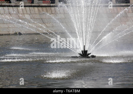 Water Spray from Fountain in the middle of river - Stock Photo