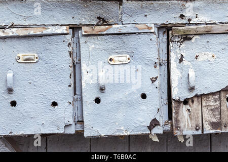 three very old and grungy mailboxes - Stock Photo