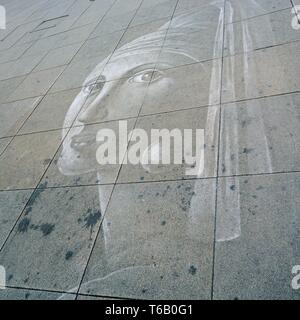 faded chalk drawing on a pedestrian zone in Berlin - Stock Photo
