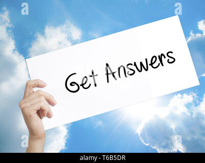 Get Answers Sign on white paper. Man Hand Holding Paper with text. Isolated on sky background - Stock Photo