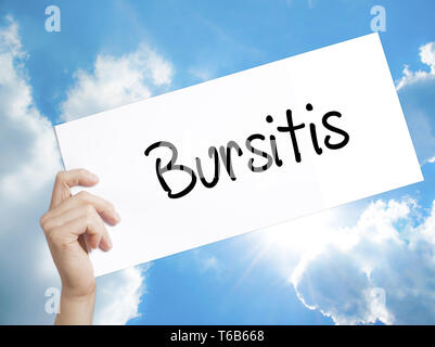 Bursitis Sign on white paper. Man Hand Holding Paper with text. Isolated on sky background. - Stock Photo
