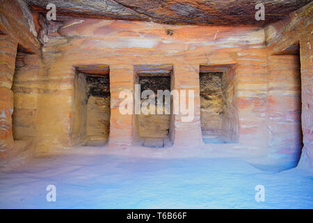 Inside a colorful sandstone  tomb, Rose Red Rock Tomb facade, Street of Facades, Petra Jordan. - Stock Photo